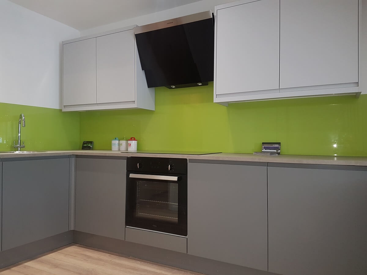 Image of a RAL Signal green kitchen splashback with socket cut outs